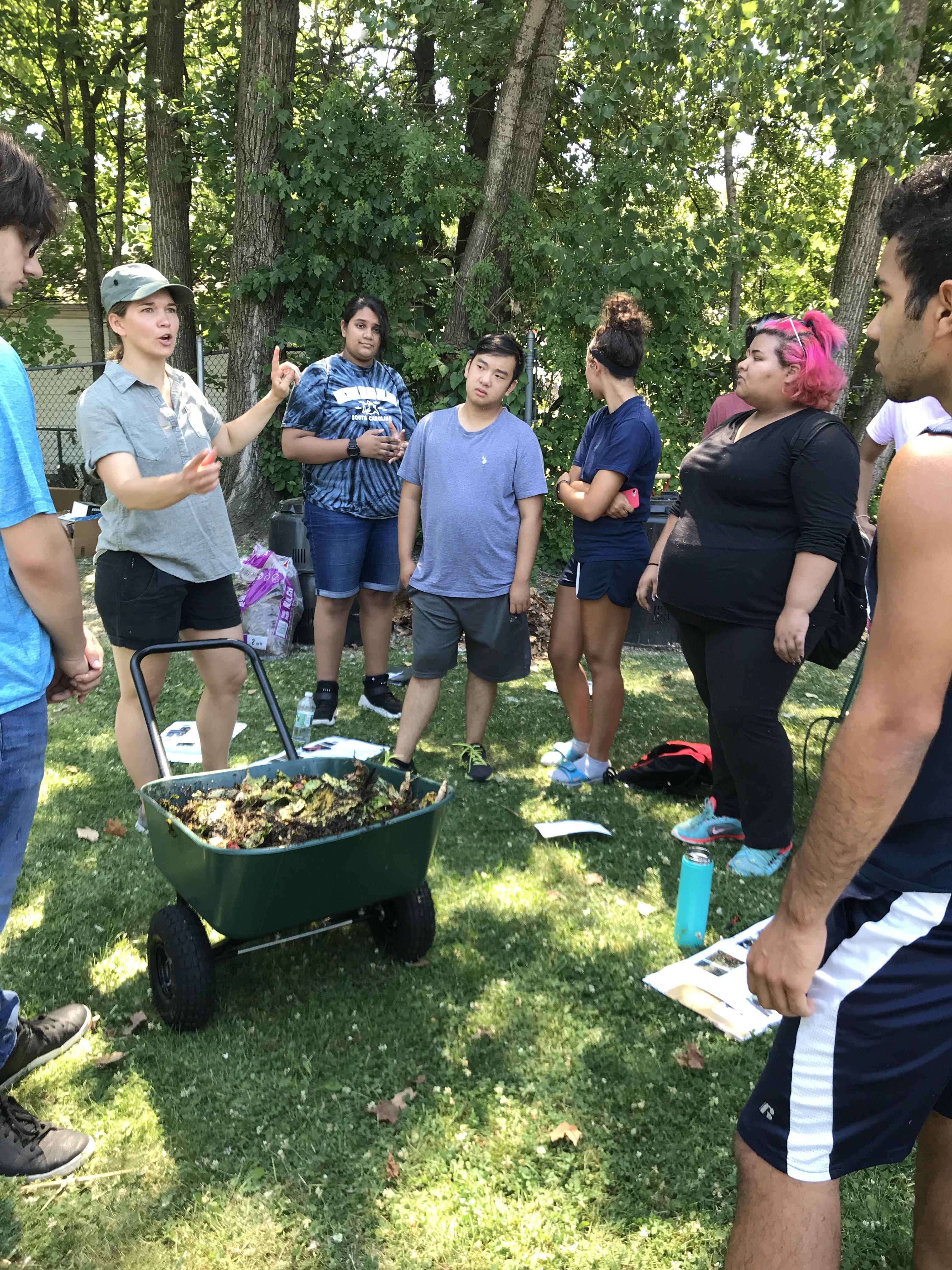 ILSR's Linda Bilsens Brolis works with participants to explore different compost recipes.
